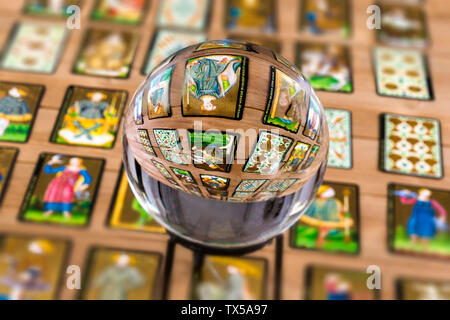 Fortune teller Crystal ball and in transparency tarot cards background . - Stock Photo