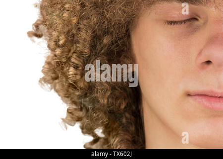 splited in half cropped portrait of a young curly European man with long curly hair and closed eyes close up. very lush male hair. curling hair men. a - Stock Photo