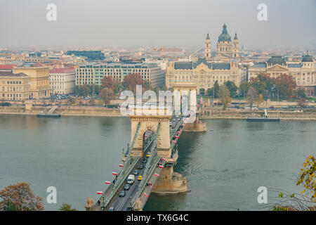 Afternoon aerial view of the famous Széchenyi Chain Bridge with Four Seasons Hotel Gresham Palace at Budapest, Hungary - Stock Photo