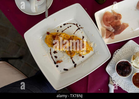 Breakfast time with scramble egg - Stock Photo
