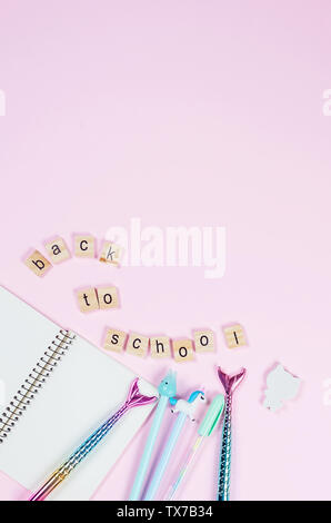 Collection of Stationary Items and Office Suppliers - pen, pencils, notebook with Inscription Back to School on pink background, copy space, top view, - Stock Photo