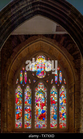 The Victoria Window, a stained glass window in St Giles & St Nicholas Church, Sidmouth, a small south coast seaside town in Devon, south-west England - Stock Photo