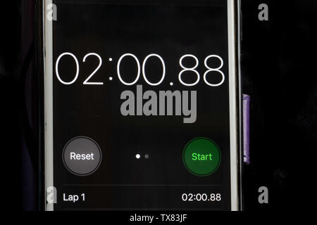Stop clock on a smart phone showing the time at 2 minutes - Stock Photo