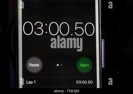 Stop clock on a smart phone showing the time at 3 minutes - Stock Photo
