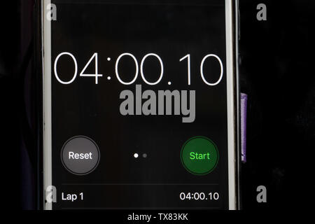Stop clock on a smart phone showing the time at 4 minutes - Stock Photo