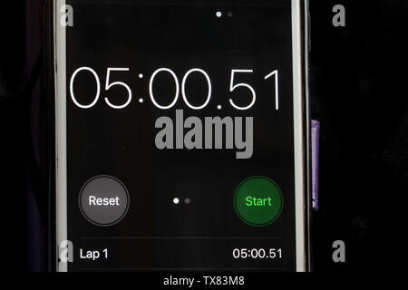 Stop clock on a smart phone showing the time at 5 minutes - Stock Photo