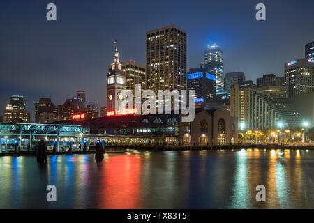 The Ferry Building and City Skyline at night, San Francisco, California, USA - Stock Photo