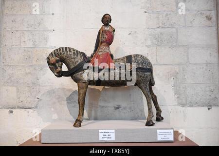 Wooden carving statue of Saint Martin de Tours in Cathedrale Notre-Dame de Laon Laon, Aisne, Hauts-de-France, France - Stock Photo