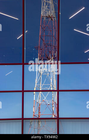 Reflection of radio transmission tower with cellular