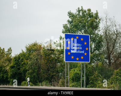 Entrance street highway sign to Germany, Member of European Union with text Bundesrepublik Deutschland - Stock Photo