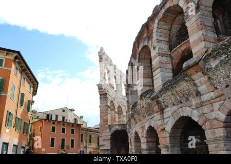 Close-up view to ruins of external walls of Arena di Verona, the famous summer open stage theater, one of the most popular in Italy Opera theaters. - Stock Photo
