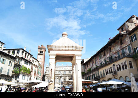 Verona/Italy - May 9, 2015: Architecture of Piazza delle Erbe in Verona during traditional fruit and vegetable market hours. - Stock Photo