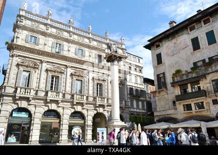 Verona/Italy - May 9, 2015: Piazza delle Erbe in Verona during traditional fruit and vegetable market hours. - Stock Photo