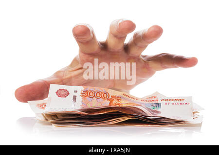Hand about to grab the money, Isolated on white background. Concept on theft or fraud with currency - Stock Photo