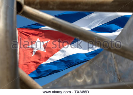 Santa Clara, Cuba, Cuban national flag waving in the wind. The symbol is framed in the Che Guevara monument of the Capiro Hill - Stock Photo