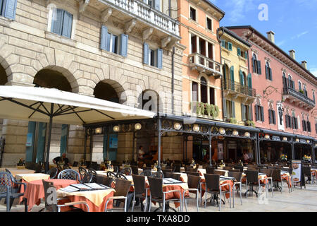 Verona/Italy - May 9, 2015: Restaurants and cafes of the Piazza delle Erbe in Verona. - Stock Photo