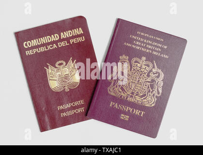 London / UK - 21st June 2019 - Peru and UK passports on a white background - Stock Photo