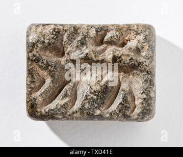 'Stamp Seal, Tabloid (image 1 of 2); Tools and Equipment; seals Gray serpentine Height:  1/2 in. (1.2 cm); Width:  15/16 in. (2.24 cm); Length:  1 3/16 in. (3 cm) Gift of Nasli M. Heeramaneck (M.76.174.512) Art of the Ancient Near East; between circa 3500 and circa 3100 date QS:P571,+3500-00-00T00:00:00Z/6,P1319,+3500-00-00T00:00:00Z/9,P1326,+3100-00-00T00:00:00Z/9,P1480,Q5727902 B.C.; ' - Stock Photo