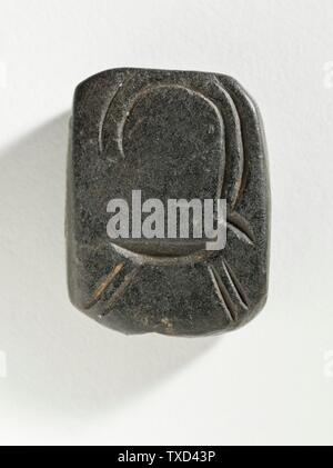 'Stamp Seal, Tabloid (image 2 of 2); Eastern Iran, circa 4th millennium B.C. Tools and Equipment; seals Black serpentine Height:  3/8 in. (0.8 cm); Width:  1 1/4 in. (3.3 cm); Length:  1 in. (2.5 cm) Gift of Nasli M. Heeramaneck (M.76.174.528) Art of the Ancient Near East Currently on public view: Hammer Building, floor 3; Circa 4th millennium B.C.; ' - Stock Photo