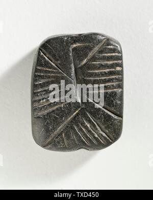 'Stamp Seal, Tabloid (image 1 of 2); Eastern Iran, circa 4th millennium B.C. Tools and Equipment; seals Black serpentine Height:  3/8 in. (0.8 cm); Width:  1 1/4 in. (3.3 cm); Length:  1 in. (2.5 cm) Gift of Nasli M. Heeramaneck (M.76.174.528) Art of the Ancient Near East Currently on public view: Hammer Building, floor 3; Circa 4th millennium B.C.; ' - Stock Photo
