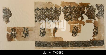 Textile Fragment;  Syria or Egypt, 13th century Textiles; fragments Linen plain weave, bk-printed 15 x 30 1/2 in. (38.1 x 77.47 cm); Mount:  17 x 34 1/2 in. (43.18 x 87.63 cm) The Madina Collection of Islamic Art, gift of Camilla Chandler Frost (M.2002.1.708) Costume and Textiles; 13th century date QS:P571,+1250-00-00T00:00:00Z/7; - Stock Photo