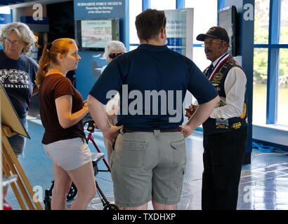 Submarine Force Museum, Groton CT USA, Jun 2019. Proud African American veteran welcoming visitors young, old, and returning veterans. - Stock Photo