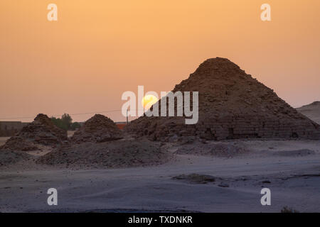 View of the pyramids of Karima, Sudan in the setting sun - Stock Photo