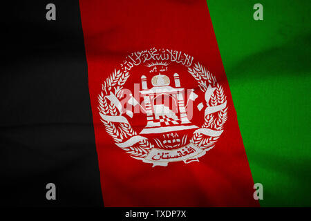 Ruffled Flag of Afghanistan Blowing in Wind - Stock Photo