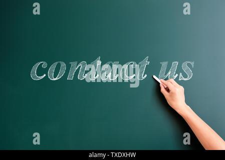 Contact us written on blackboard q - Stock Photo