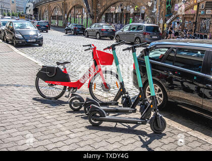 Germany, Berlin, Mitte. 24th June 2019. German parliament legalises electric scooters. E-scooters have recently been made legal for street use in Germany and are making an appearance on city streets. Use is restricted to bike lanes & streets. The maximun speed allowed is 20kpm and under- fourteens are not permitted to use the scooters. - Stock Photo