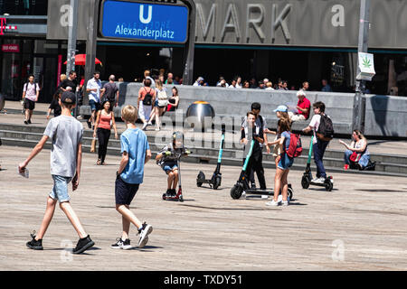 Germany, Berlin, Mitte., Alexander Platz. 24th June 2019. German parliament legalises electric scooters. E-scooters have recently been made legal for street use in Germany and are making an appearance on city streets. Use is restricted to bike lanes & streets. The maximun speed allowed is 20kpm and under- fourteens are not permitted to use the scooters. - Stock Photo