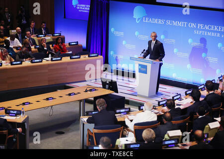 *** POOL ***NEW YORK, NY - SEPTEMBER 28:  (AFP OUT) U.S. President Barack Obama delivers remarks during the Leaders' Summit on Peacekeeping during the 70th annual UN General Assembly at the UN headquarters September 28, 2015 in New York City. Obama held a bilateral meeting with Indian Prime Minister Narendra Modi and with have a face-to-face meeting with Russian President Vladimir Putin later in the day.  (Photo by Chip Somodevilla/Getty Images) - Stock Photo