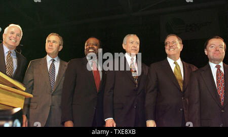 DUR2000010901 - 09 JANUARY 2000 - DURHAM, NEW HAMPSHIRE, USA:  The six Republican presidential candidates from left to right; U.S. Senator John McCain, Texas Governor George W. Bush, former U.N. Ambassador Alan Keyes, U.S. Senator Orrin Hatch, publisher Steve Forbes and former Reagan administration aide Gary Bauer pose before their 10 minute speeches at the New Hampshire Republican's 'A Salute to the Next President' dinner, January 9, at The University of New Hampshire's Whittemore Center in Durham.  rg/lkm/Lee K. Marriner  UPI - Stock Photo