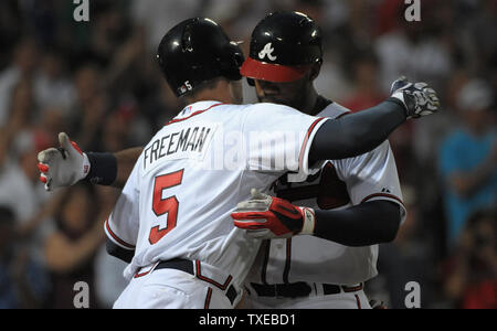 Atlanta Braves' Jason Heyward is congratulated at the plate by teammate Freddie Freeman after Heyward's two run homer against the Pittsburgh Pirates in the fifth inning at Turner Field in Atlanta, June 3, 2013. Freeman also homered during the inning. UPI/David Tulis - Stock Photo