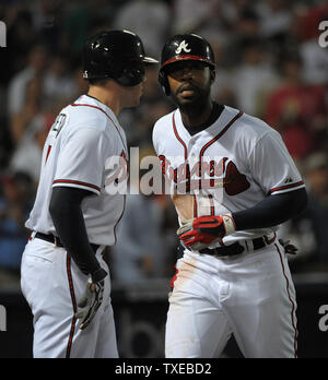Atlanta Braves' Jason Heyward, right, is congratulated at the plate by teammate Freddie Freeman after Heyward's two run homer against the Pittsburgh Pirates in the fifth inning at Turner Field in Atlanta, June 3, 2013.  UPI/David Tulis - Stock Photo