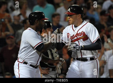 Atlanta Braves' Freddie Freeman, right, is congratulated by Justin Upton after Freeman's two run homer against the Pittsburgh Pirates in the fifth inning at Turner Field in Atlanta, June 3, 2013.  UPI/David Tulis - Stock Photo
