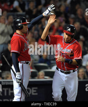 Atlanta Braves' Paul Janish (R) is congratulated by teammate Freddie Freeman after he scores against the Washington Nationals in the third inning at Turner Field in Atlanta, August 16, 2013. Janish scored on a Washington throwing error by second baseman Anthony Rendon. UPI/David Tulis - Stock Photo