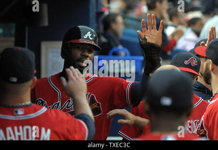 Atlanta Braves' Jason Heyward (C) is congratulated in the dugout after scoring against the Washington Nationals in the first inning at Turner Field in Atlanta, August 16, 2013. Heyward scored on a double play hit by Braves' Freddie Freeman. UPI/David Tulis - Stock Photo