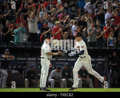 Atlanta Braves' Freddie Freeman (5) is congratulated by third base coach Brian Snitker after Freeman's solo home run against the San Diego Padres in the sixth inning at Turner Field in Atlanta, September 14, 2013. Freeman's home run gave Atlanta a 2-0 lead.  UPI/David Tulis - Stock Photo