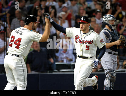 Atlanta Braves' Freddie Freeman (5) is congratulated by teammate Evan Gattis after Freeman's solo home run against the San Diego Padres in the sixth inning at Turner Field in Atlanta, September 14, 2013. Freeman's home run gave Atlanta a 2-0 lead. UPI/David Tulis - Stock Photo