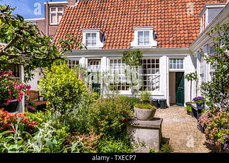 Haarlem, The Netherlands - May 31, 2019: White Almshouse (hofje) originally providing housing for poor families and elderly ladies. - Stock Photo