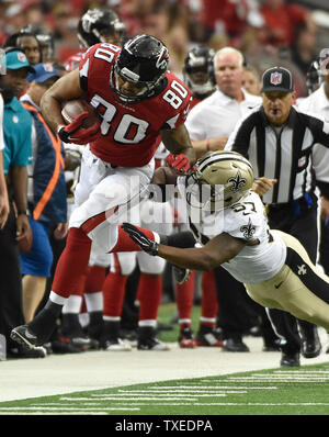 New Orleans Saints' David Hawthorne (57) pushes Atlanta Falcons tight end Levine Toilolo (80) out of bounds after a first down during the first half of their football game at the Georgia Dome in Atlanta on September 7, 2014. UPI/David Tulis - Stock Photo