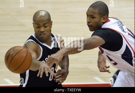 Atlanta Hawks' Al Horford (15) steals the ball from Brooklyn Nets' Jarrett Jack (0) during the first half of an NBA game at Philips Arena in Atlanta, January 28, 2015. Photo by David Tulis/UPI - Stock Photo