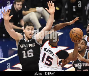 San Antonio Spurs' Aron Baynes (16) blocks the shot by Atlanta Hawks' Al Horford (15) during the first half of an NBA game at Philips Arena in Atlanta, March 22, 2015. Photo by David Tulis/UPI - Stock Photo