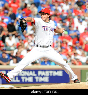 Texas Rangers starting pitcher Derek Holland throws against the Detroit Tigers in game two of the ALCS at Rangers Ballpark in Arlington on October 10, 2011 in Arlington, Texas.   The Rangers lead the best of seven series 1-0.   UPI/Ian Halperin - Stock Photo