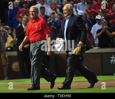 Former President George Bush (L) and Nolan Ryan leave the fieldafter the ceremonial first pitch for game 4 of the World Series at Rangers Ballpark in Arlington, Texas on October 23, 2011.        UPI/Kevin Dietsch - Stock Photo
