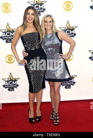 Actresses Sofia Vergara, left, and Reese Witherspoon arrive at the 50th annual Academy of Country Music Awards held at AT&T Stadium in Arlington, Texas on April 19, 2015. Photo by John Angelillo/UPI - Stock Photo