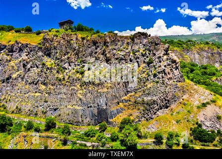 Garni Temple on a side of the Garni Gorge in Armenia - Stock Photo
