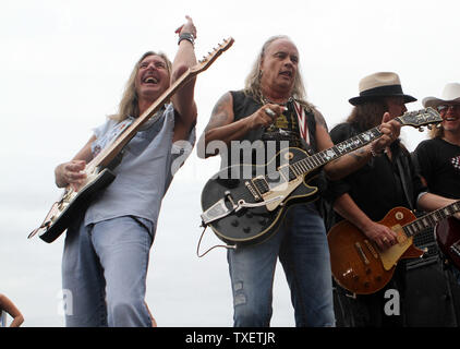 Rickey Medlocke (C), Gary Rossington (R) and Mark Matejka of Lynyrd Skynyrd perform in concert prior to the start of the 52 Annual AdvoCare 500 at Atlanta Motor Speedway Speedway in Hampton, Georgia on September 4, 2011.  UPI Photo/Martin Fried - Stock Photo