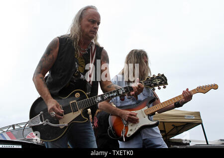 Rickey Medlocke (L) and Mark Matejka of Lynyrd Skynyrd perform in concert prior to the start of the 52 Annual AdvoCare 500 at Atlanta Motor Speedway Speedway in Hampton, Georgia on September 4, 2011.  UPI Photo/Martin Fried - Stock Photo